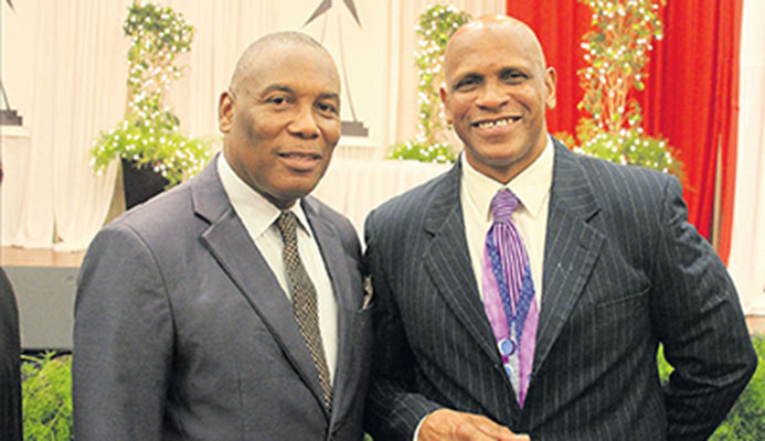 President of the T&T Track and Field Association (TTSSTFA) Phillip Allard, right, and president of the NAAA, Ephraim Serrette at the NAAA's annual awards at the Radisson Hotel, Wrightson Road, Port of Spain on January 7.