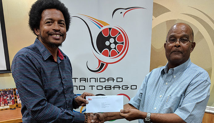 TTOC's President, Brian Lewis receiving the cheque from Kenneth Ferguson of the KENSON