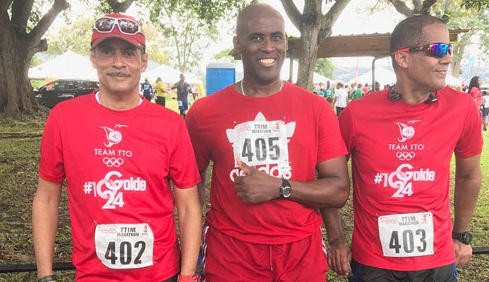 Walking in support of the T&T Olympic Committee fundraising project during last Sunday's T&T International Marathion were sports commentator and writer Andre Errol Baptiste, Olympic shooter Roger Daniel and sports enthausaist Nigel Mark Baptiste.
