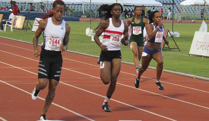 Michelle Lee Ahye of club Rebirth, left, finished first in the 100m prelims at the NGC/Natonal Association of Athletics Administrations Open Championships at the Hasely Crawford Stadium yesterday. Placing second was Kamaria Durant of Simplex and third, Tahesia Harrington-Scott of British Virgin. PHOTO BY AYANNA KINSALE